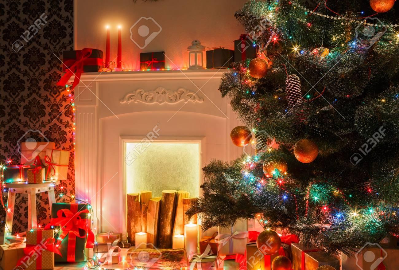 Christmas Living Room Decorations. Beautiful Xmas Lights Garland, Decorated  Christmas Tree Near Fireplace.