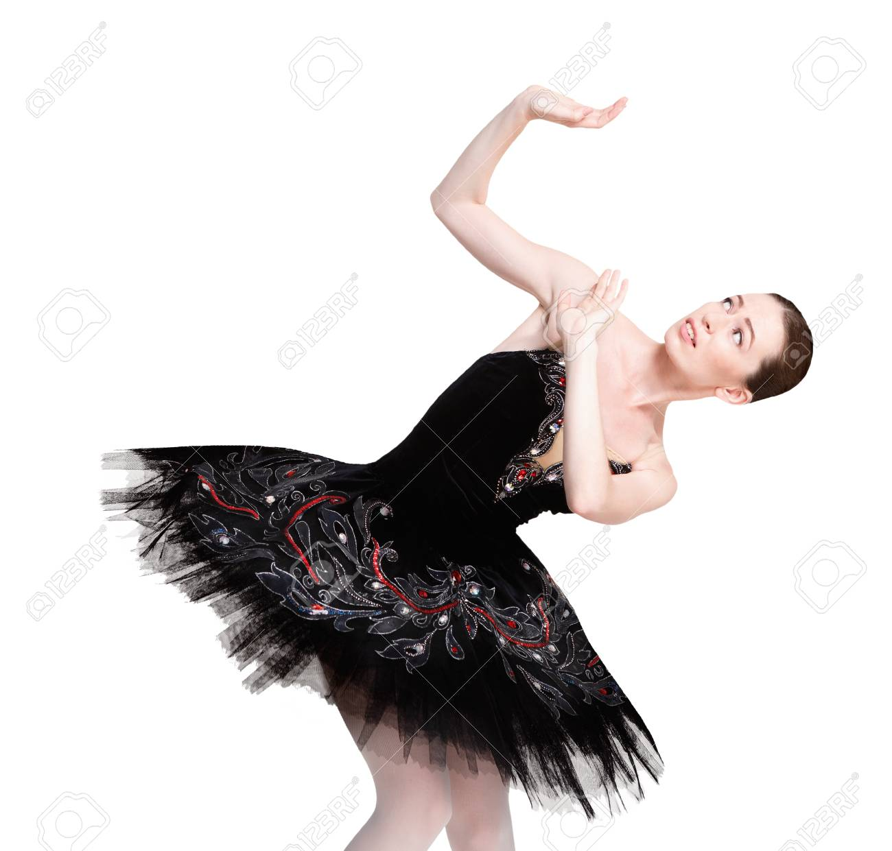 4a55782a088 Scared Ballerina In Black Swan Dress Against White Background
