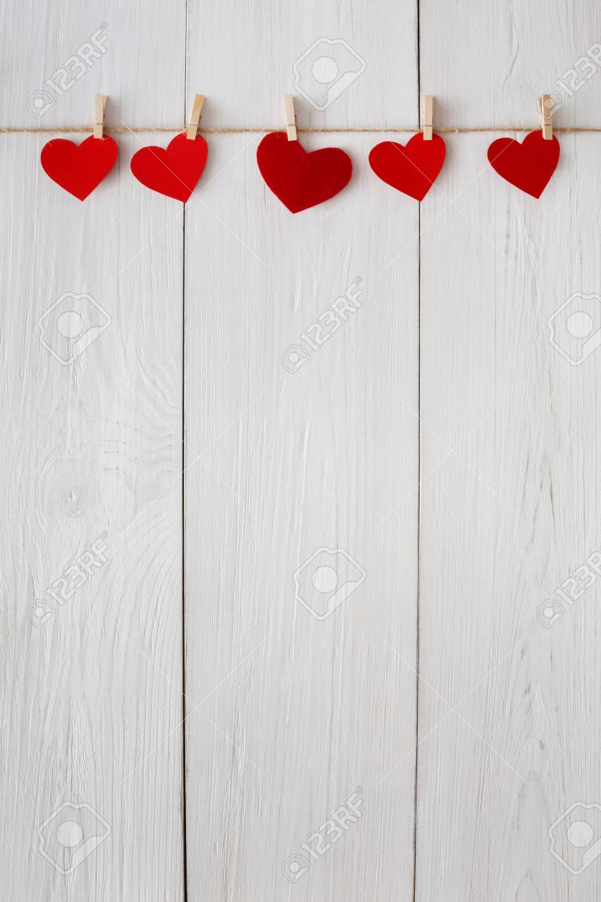 Valentine Background With Red Paper Hearts Row Border On Clothespins Stock Photo Picture And Royalty Free Image Image 68853967