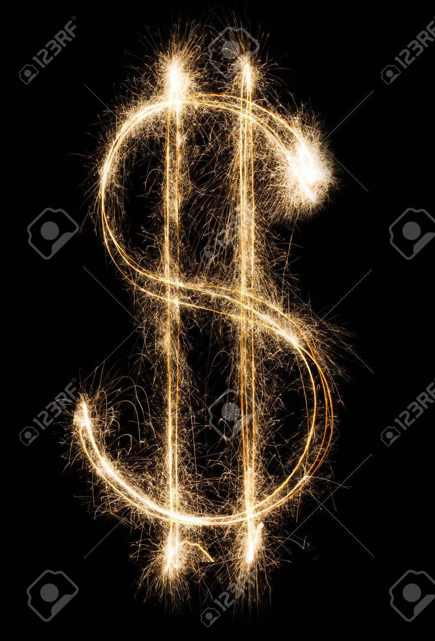 Money and finance business concept. Dollar sign from shining sparkler firework on black background - 70271416