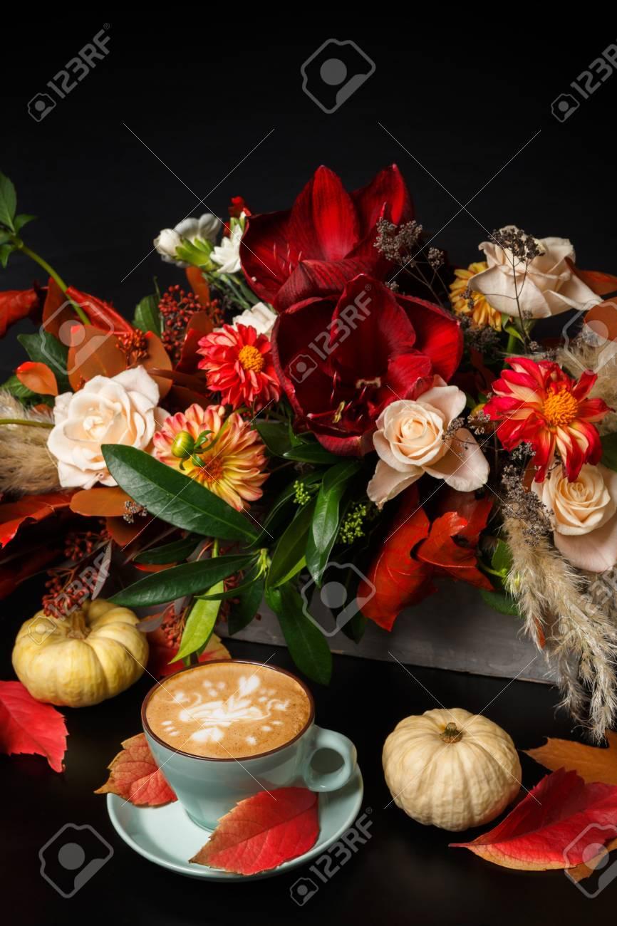 Cappuccino and beautiful flowers bouquet still life flower shop cappuccino and beautiful flowers bouquet still life flower shop composition coffee cup pumpkins izmirmasajfo