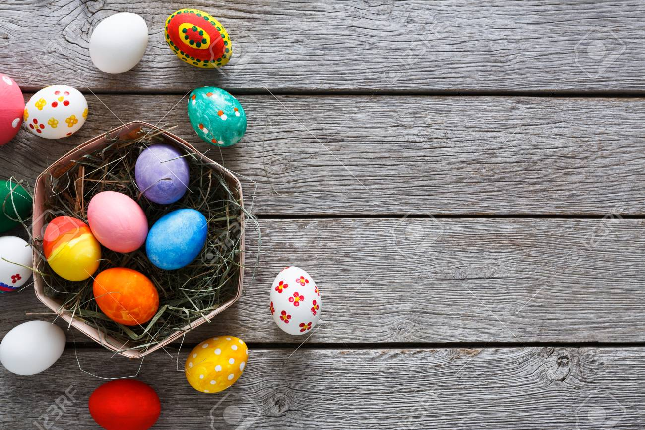 Handmade Easter Diy Painted Eggs In Carton Nest On Wood Background