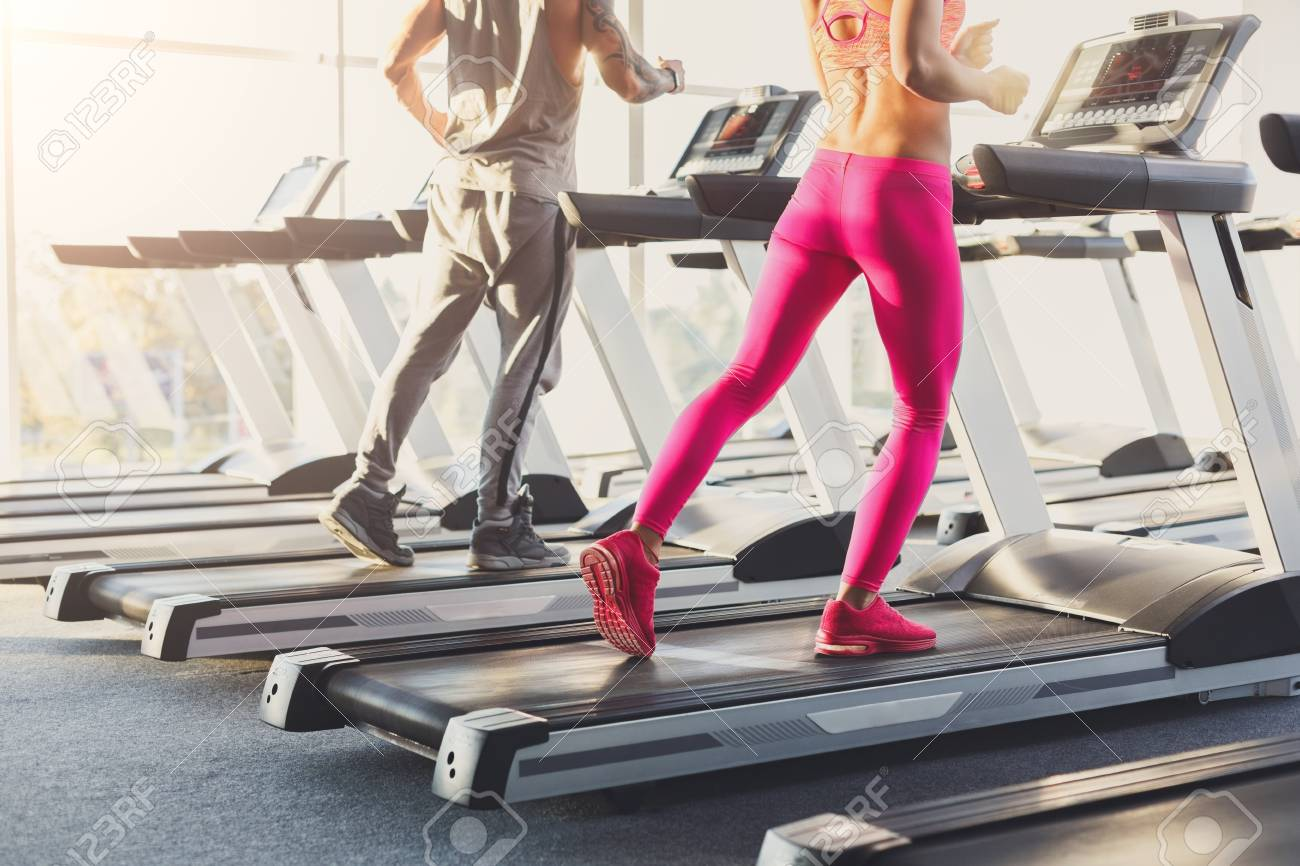 Male And Female Legs Run On Treadmills Man Woman Cardio Workout In Fitness Club
