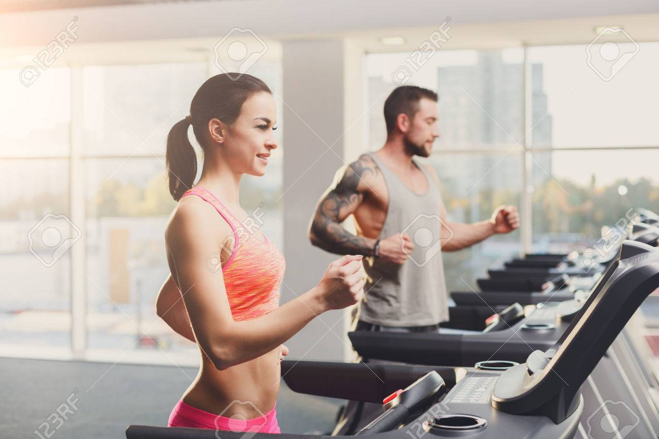 Man And Woman Cardio Workout In Fitness Club Healthy Lifestyle