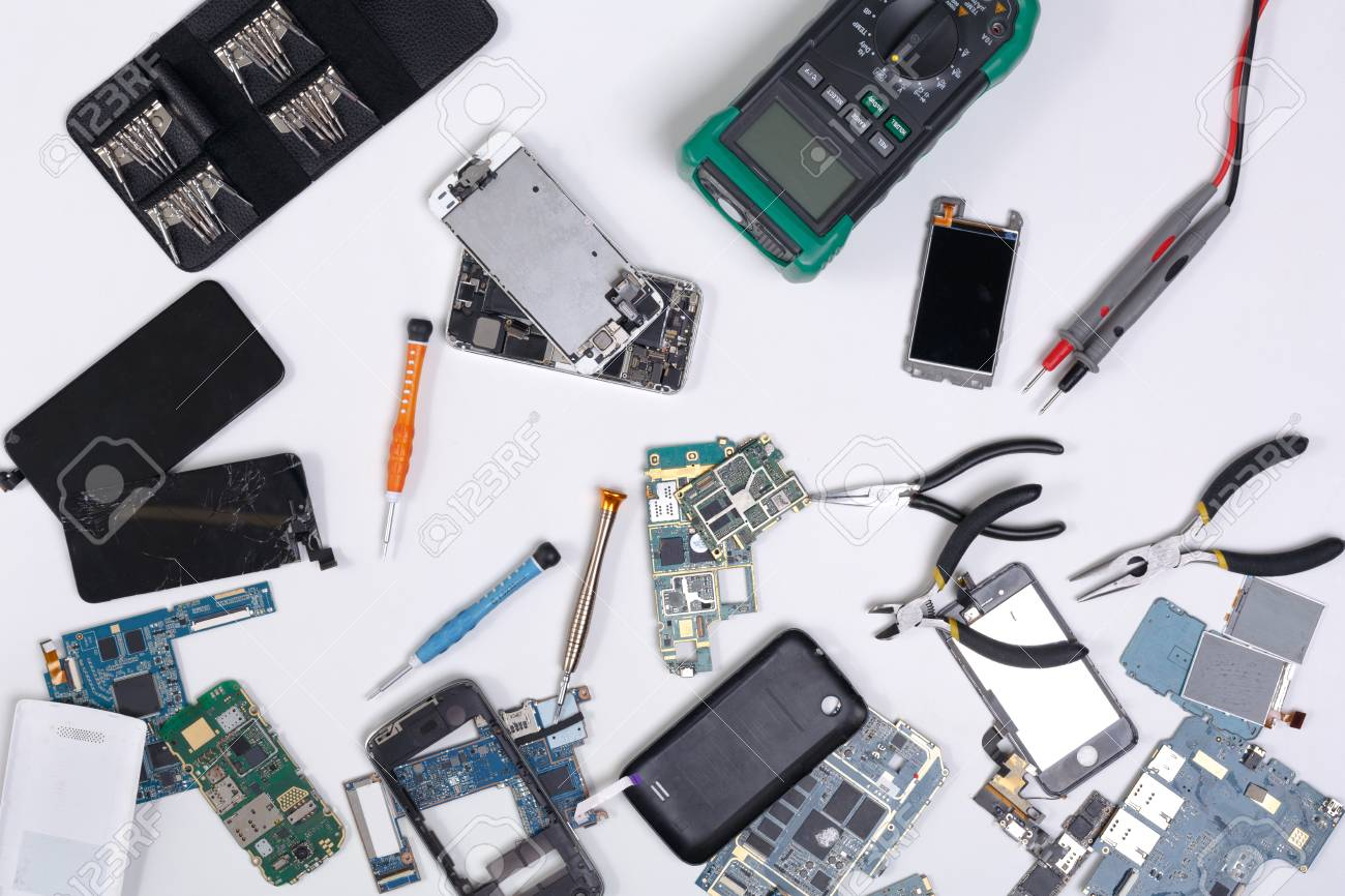 Mobile phone repair flat lay background, top view of workplace at service  center. Smartphone