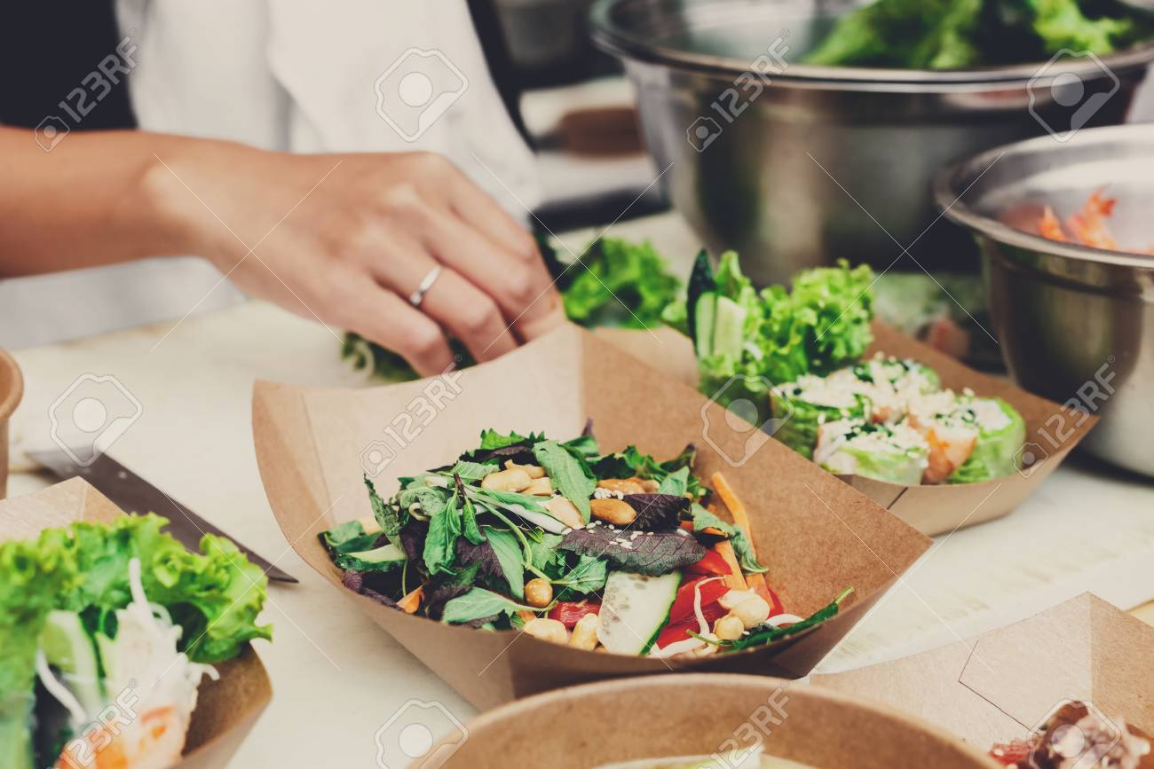 Stock Photo - Street food festival catering service. Vegetable salads in kraft paper plates sold outdoors at local market place shallow depth of field & Street Food Festival Catering Service. Vegetable Salads In Kraft ...