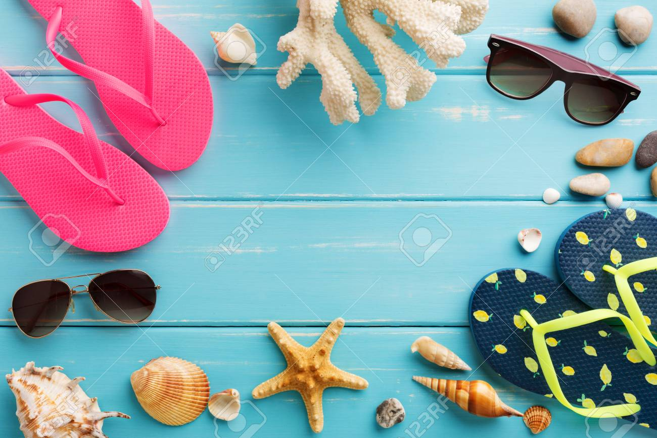 5b7259b984545 Stock Photo - Vacation background on blue wood