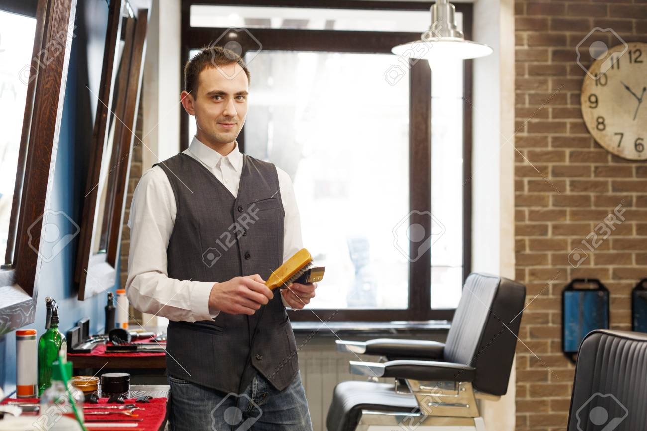 professional hairstylist in male barbershop stock photo 83994945