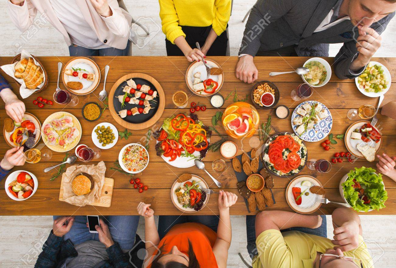 Dinner table top view - Friends Dinner Table Top View People Eat Healthy Food Together Home Party Stock Photo