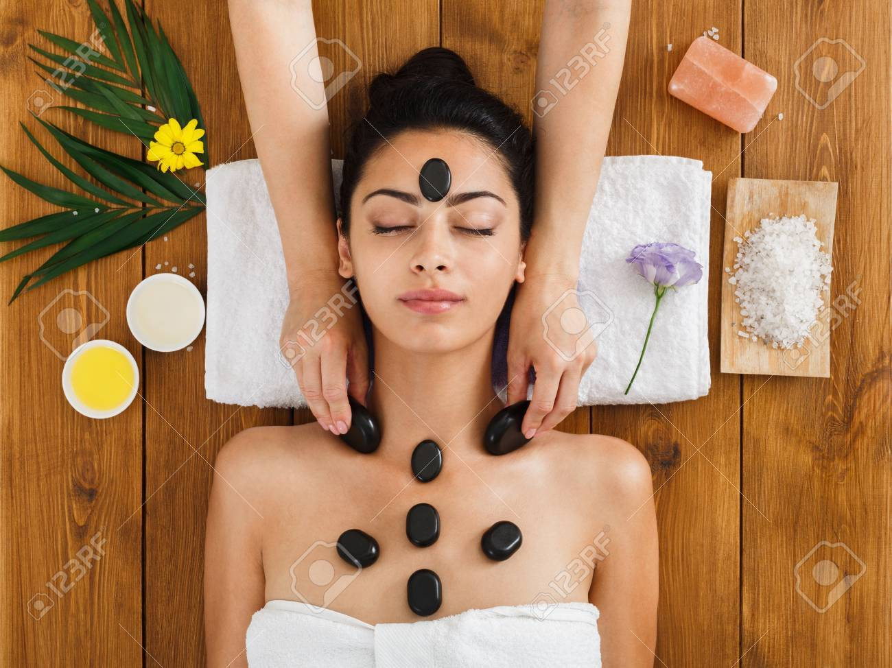 black marble stone face massage in indian spa, top view. female