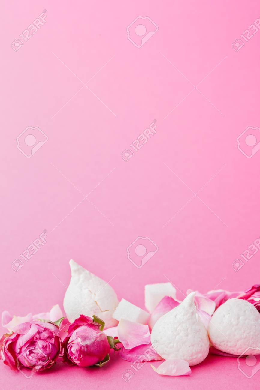 Sweets And Flowers At Pink Background French Meringues And Rose