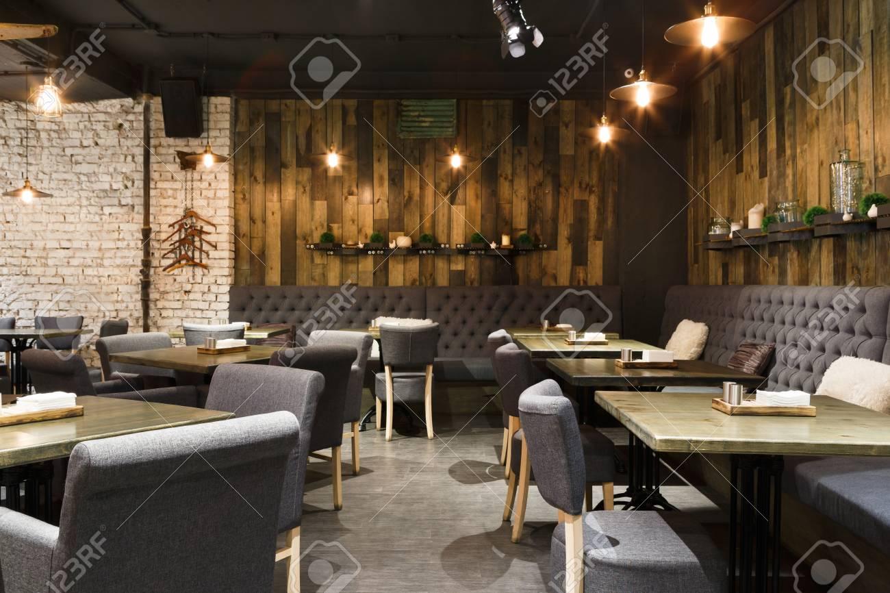 Cozy wooden interior of restaurant, copy space. Comfortable modern..
