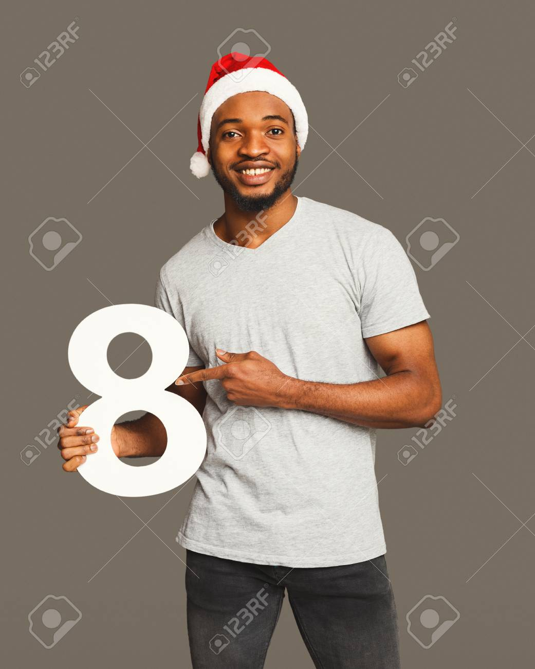 4888614f3 Happy black man with 8 number portrait. African-american boy..
