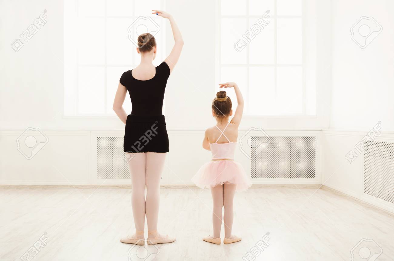 fd97cedf0782 Little Girl Learning Ballet With Teacher Copy Space. Cute Small ...