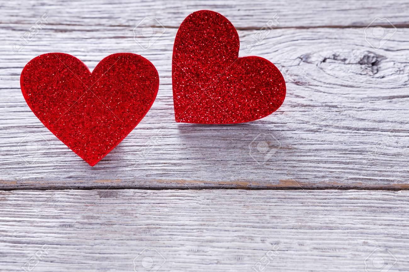 Valentine Background With Handmade Glitter Hearts On Grey Wood