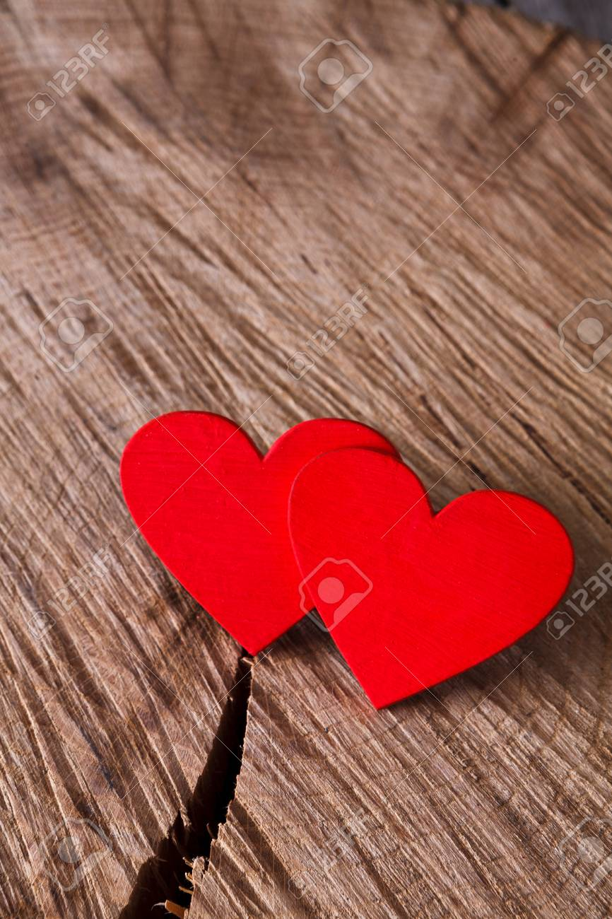 Valentine Background With Red Handmade Hearts On Cracked Rustic