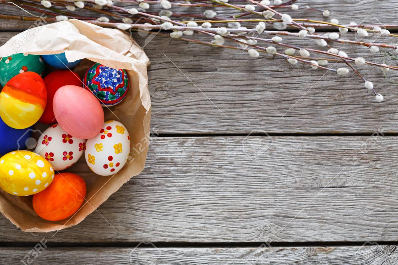 Handmade Easter Diy Painted Eggs In Craft Paper Nest On Wood