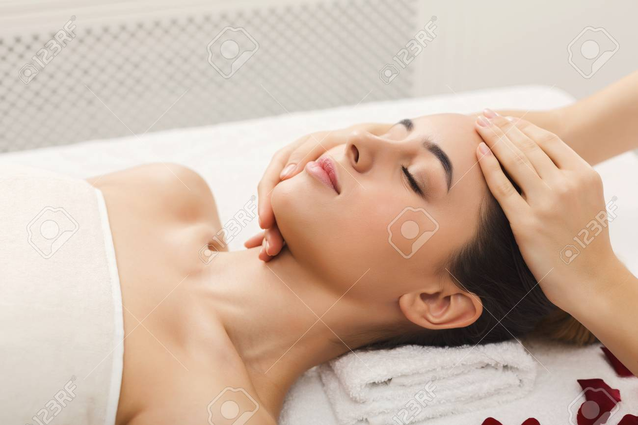 Woman Enjoying Anti Aging Facial Massage Pretty Girl Getting Stock Photo Picture And Royalty Free Image Image 95164755