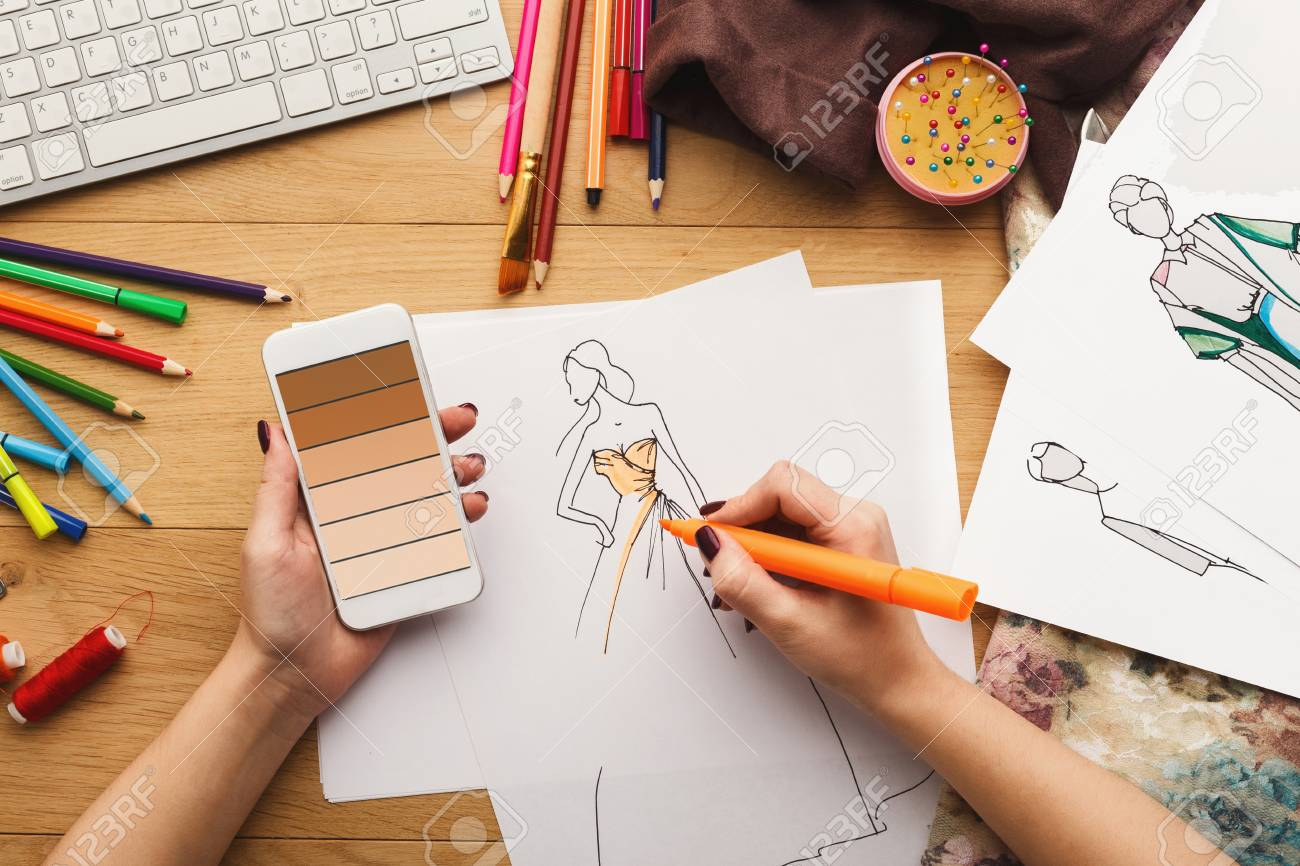 Top View On Fashion Designer At Work Female Hands Drawing Clothes Stock Photo Picture And Royalty Free Image Image 95768446