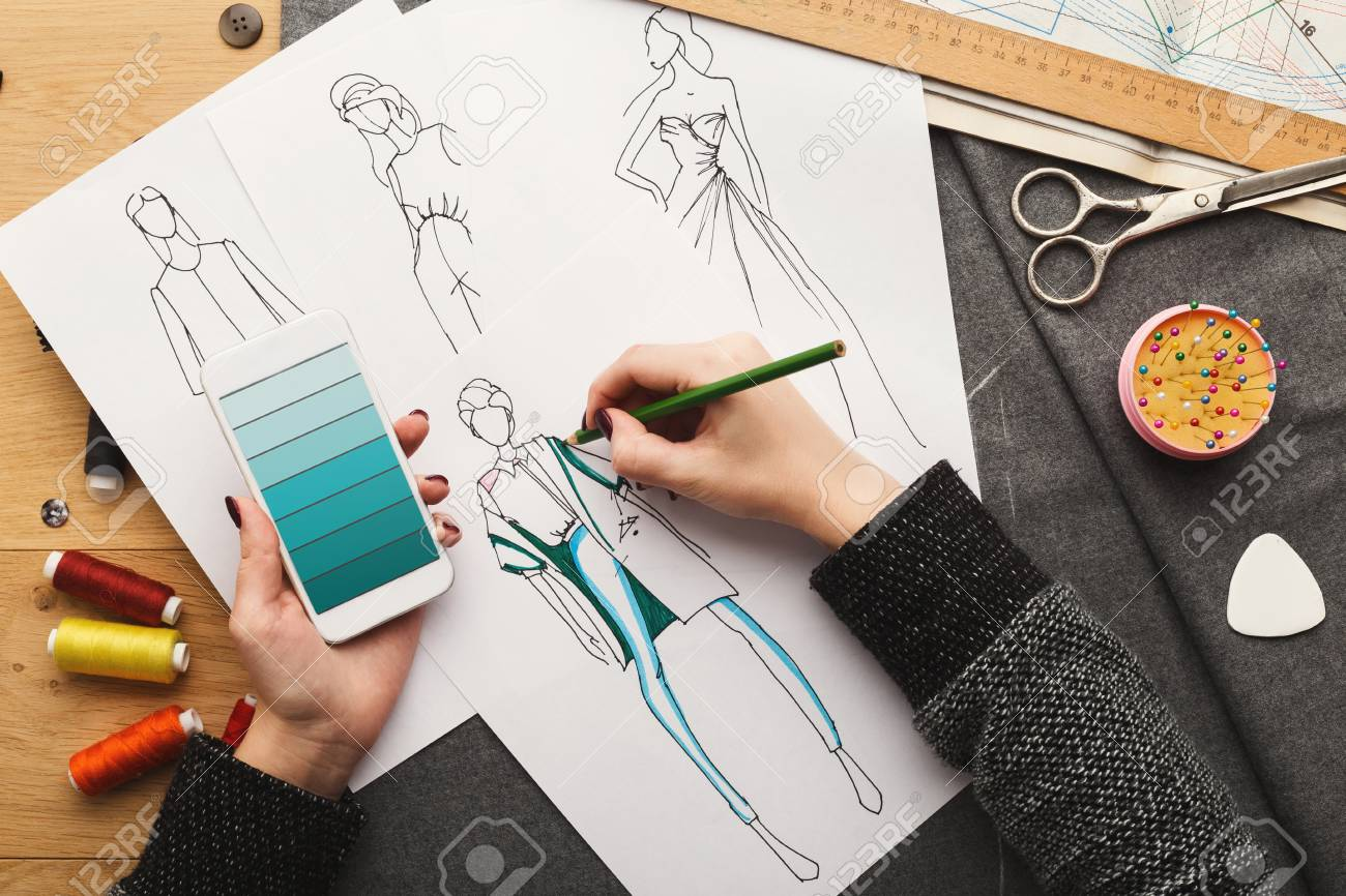 Top View On Fashion Designer At Work Female Hands Drawing Clothes Stock Photo Picture And Royalty Free Image Image 95768487