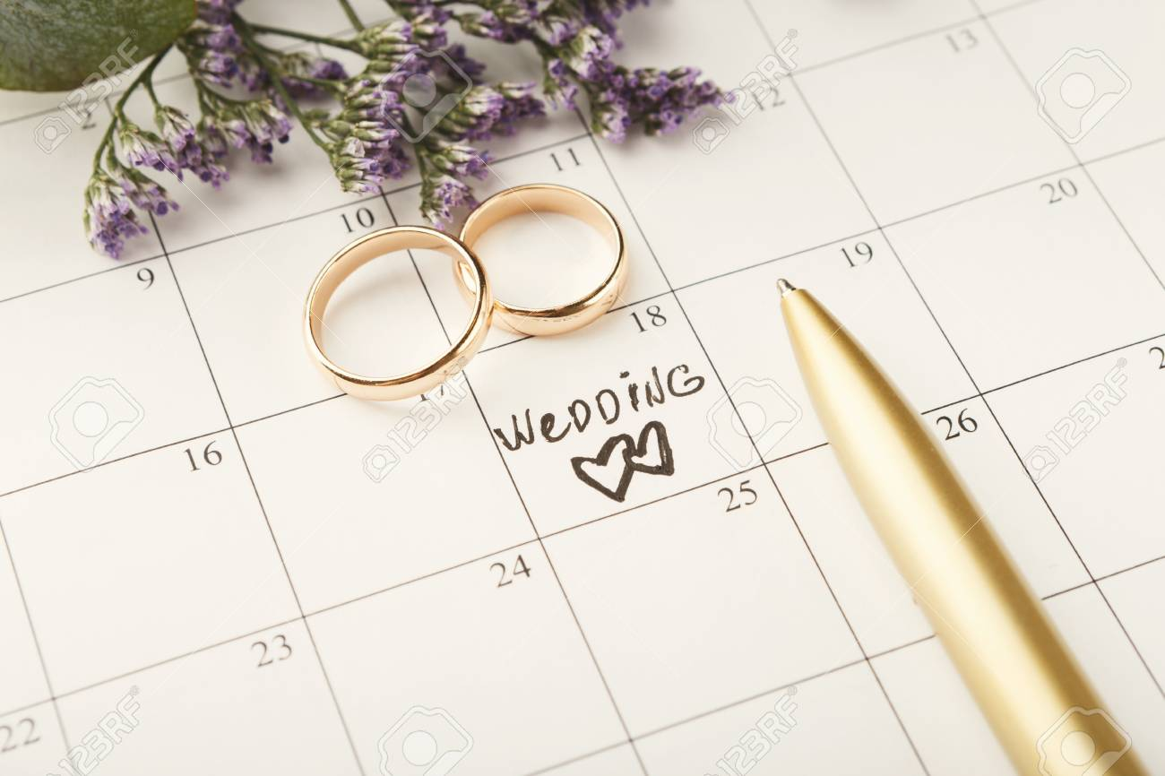 Word Wedding, Two Hearts And Gold Rings On Calendar With Sweet