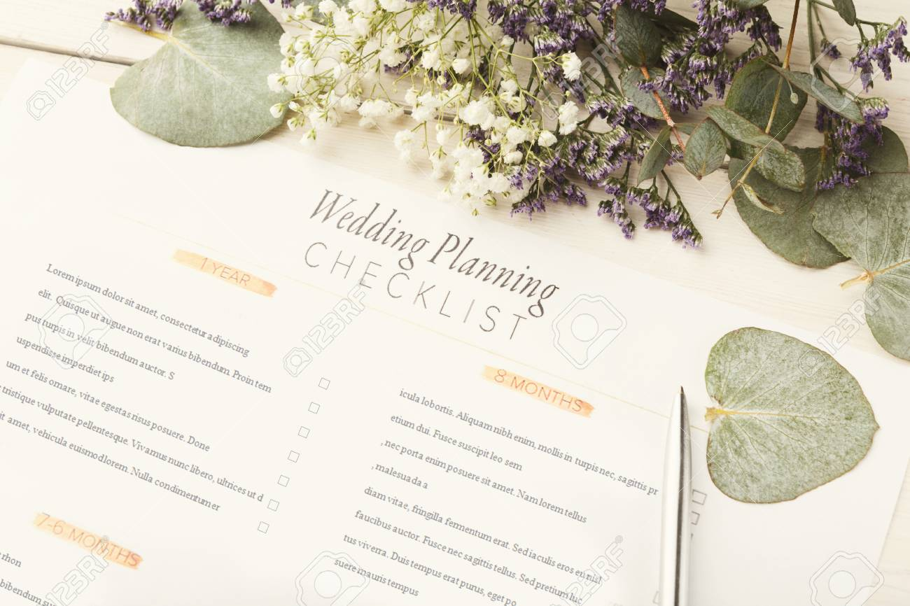wedding background with checklist paper planner and cute flowers