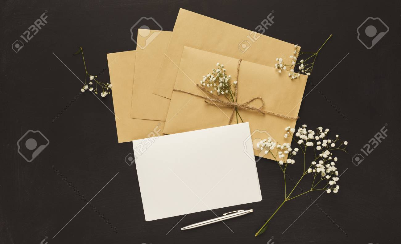 Wedding Invitations And Craft Envelopes On Black Background