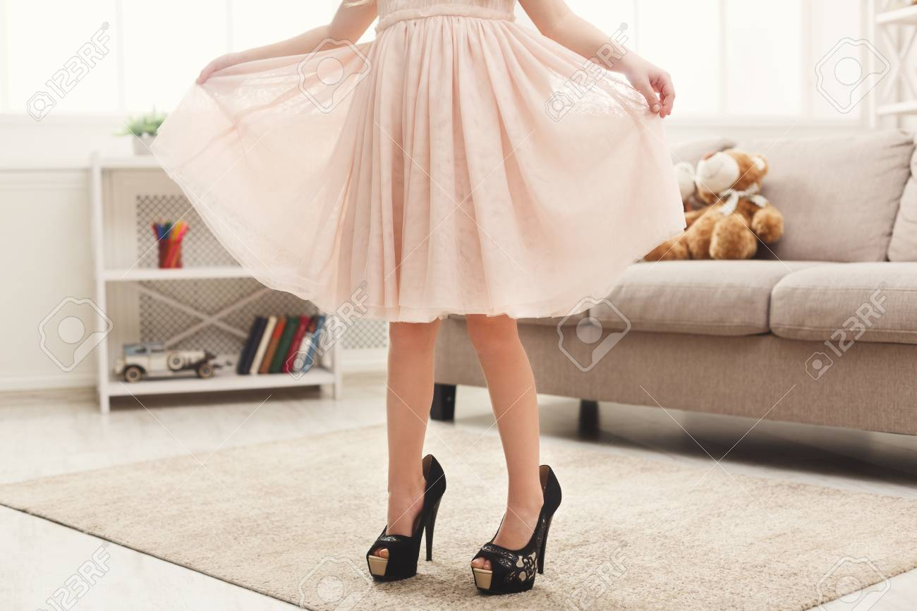 Pretty Little Girl In Mother`s Shoes