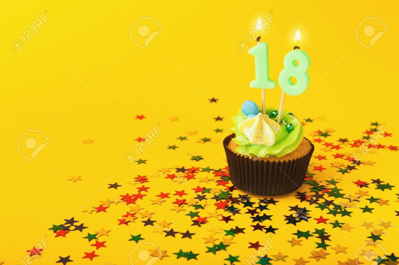 18th Birthday Cupcake With Candle And Sprinkles On Yellow Background Card Mockup Copy Space