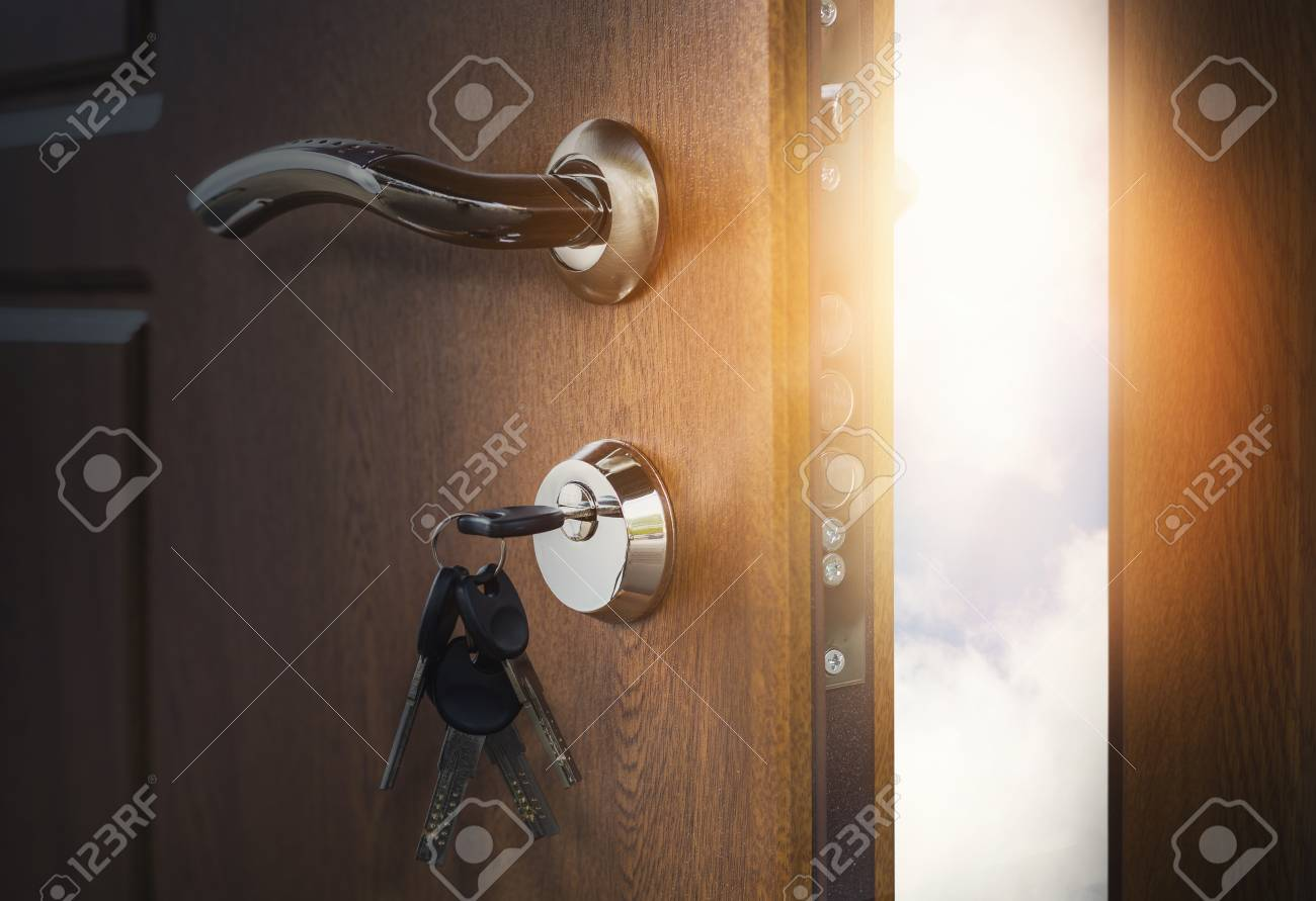 Half open door with keys in keyhole. Doorway to heaven and success. Entrance or & Half Open Door With Keys In Keyhole. Doorway To Heaven And Success ...