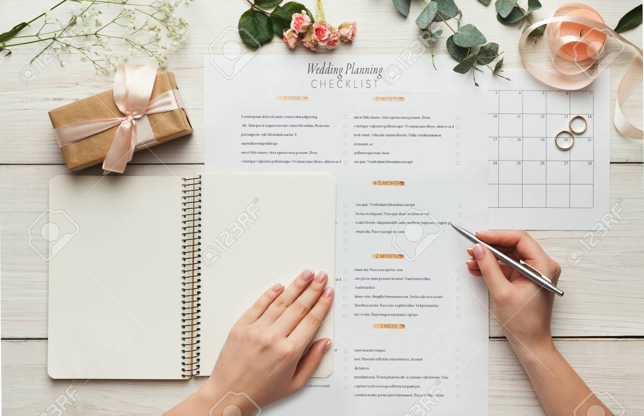 wedding background with checklist and calendar female hands stock