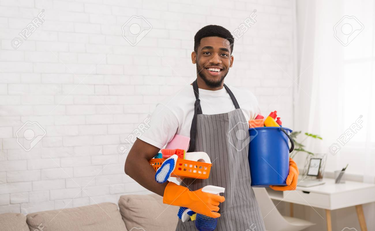 Cheerful African-american Guy Cleaner Holding Lots Of Detergents,.. Stock  Photo, Picture And Royalty Free Image. Image 111784306.