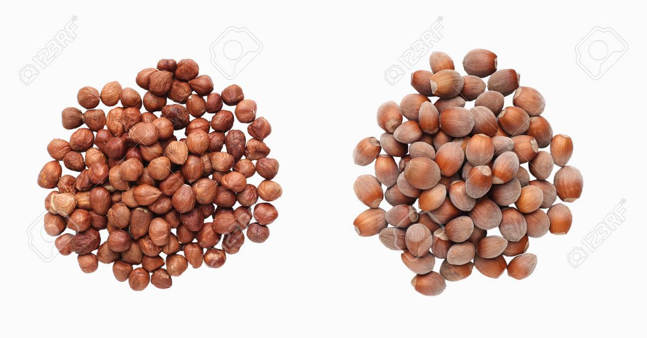 Piles Of Hazelnuts Isolated Over The White Background Top View