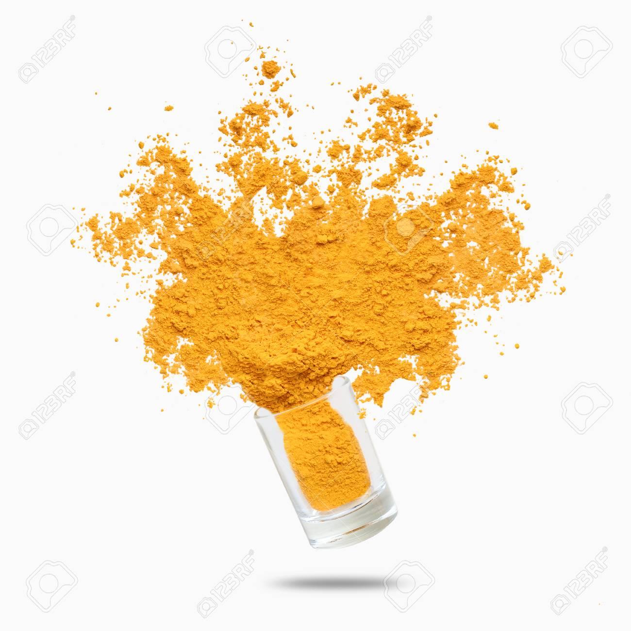 Condiment splash. Yellow turmeric powder flying, isolated on white background - 118032787