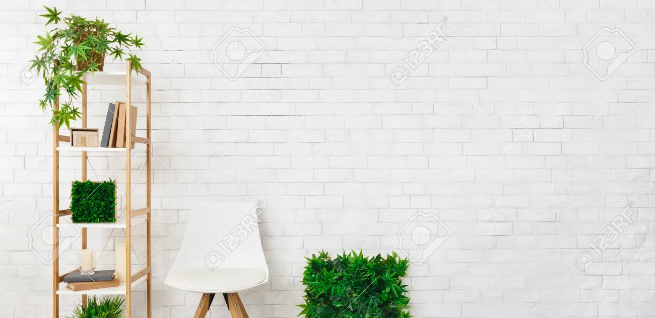 Shelving With House Plants And Scandinavian Chair At White Brick Stock Photo Picture And Royalty Free Image Image 118460804