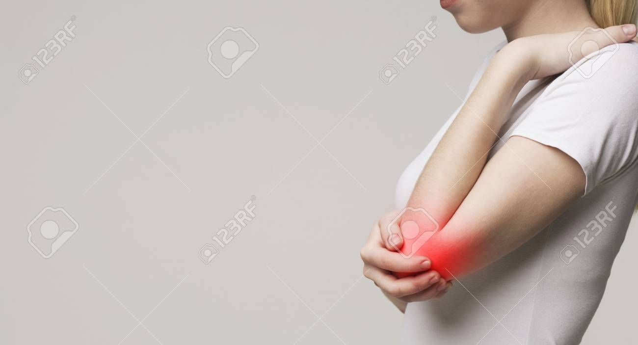 Woman suffering from chronic joint rheumatism. Elbow pain and treatment concept - 121278250