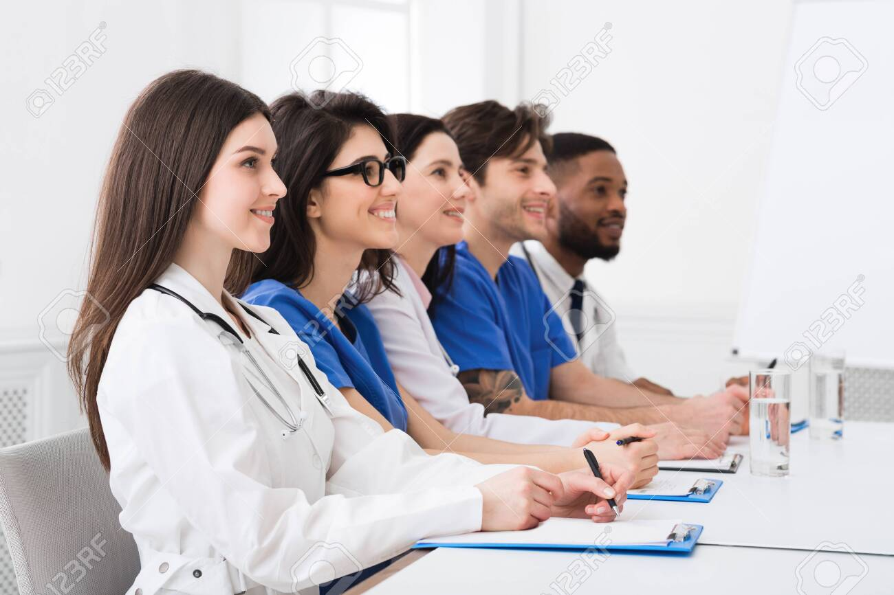 Medical Seminar. Doctors And Interns Listening To Professor In Conference Room - 124593735
