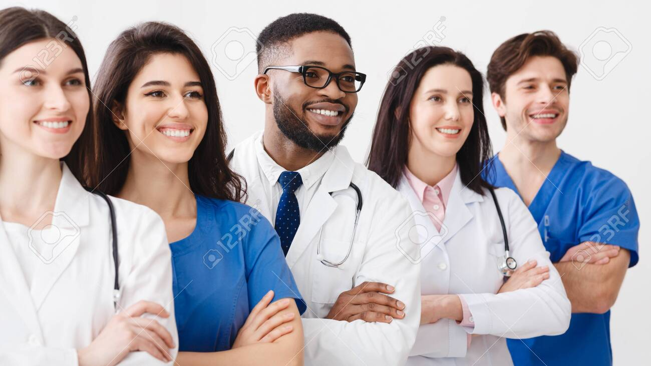 Happy Medical Staff Standing Together In Clinic, Posing With Crossed Arms - 125091578