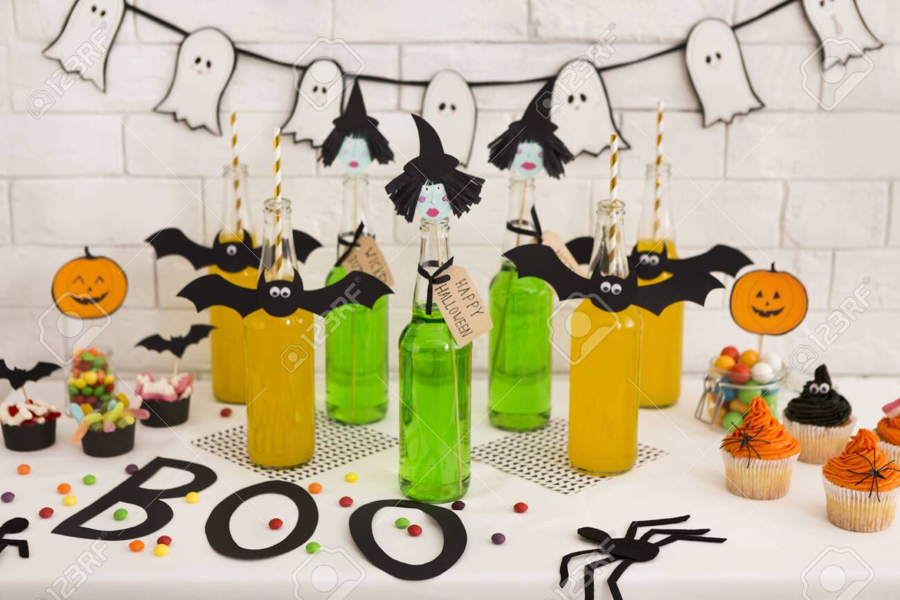 Halloween Party In Office With Fresh Toxic Cocktails And Decorations