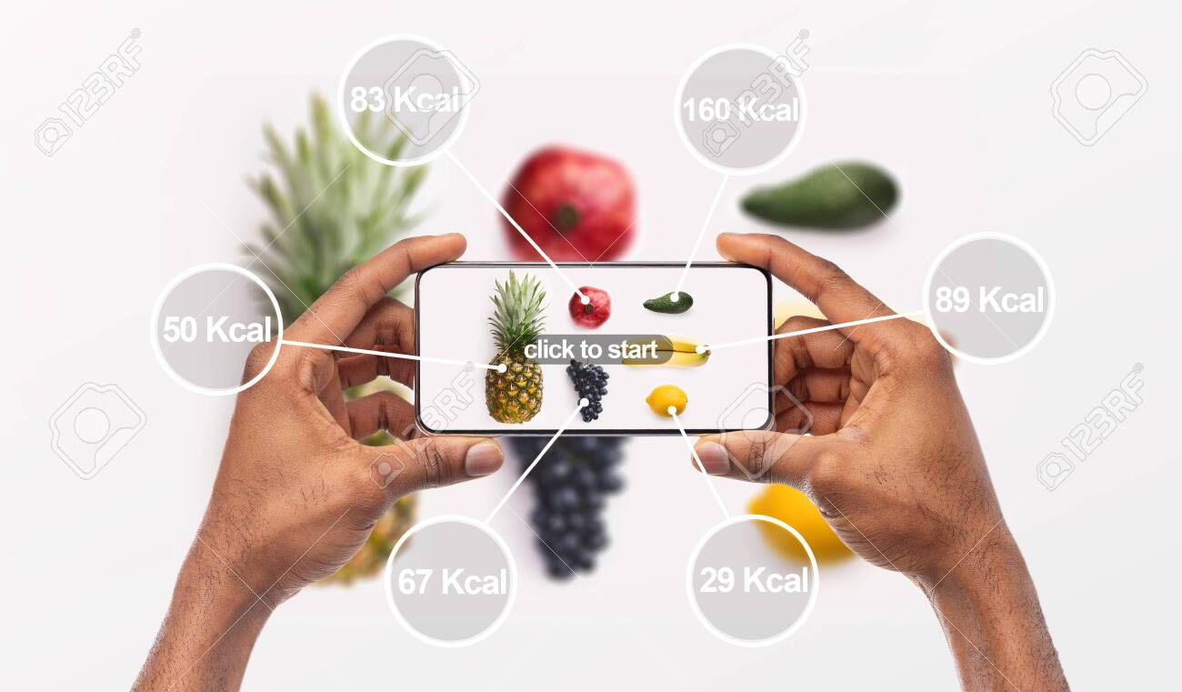 Woman holding cellphone with application which counting calories by photo, background, panorama - 130407110