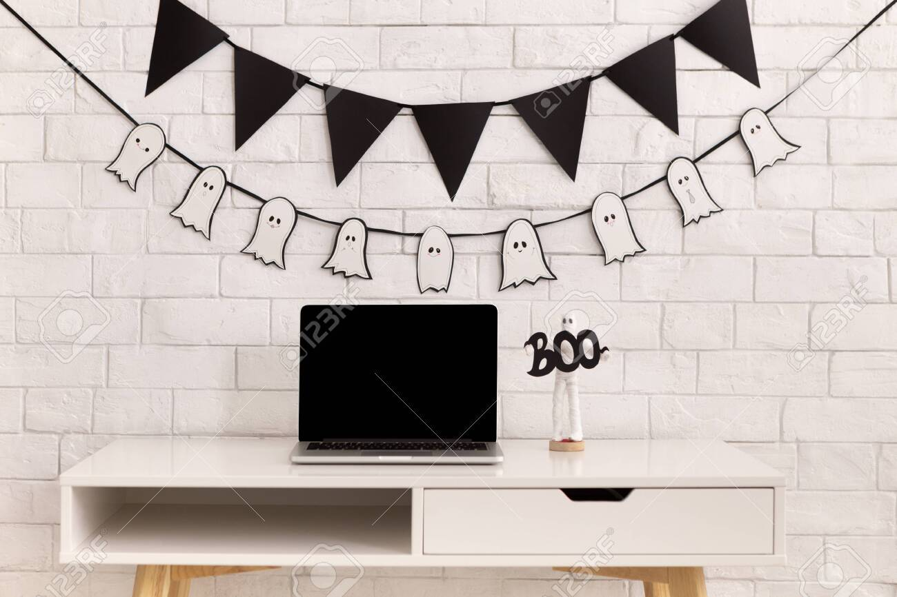 Halloween Decorations In Modern Office With Laptop Black Blank