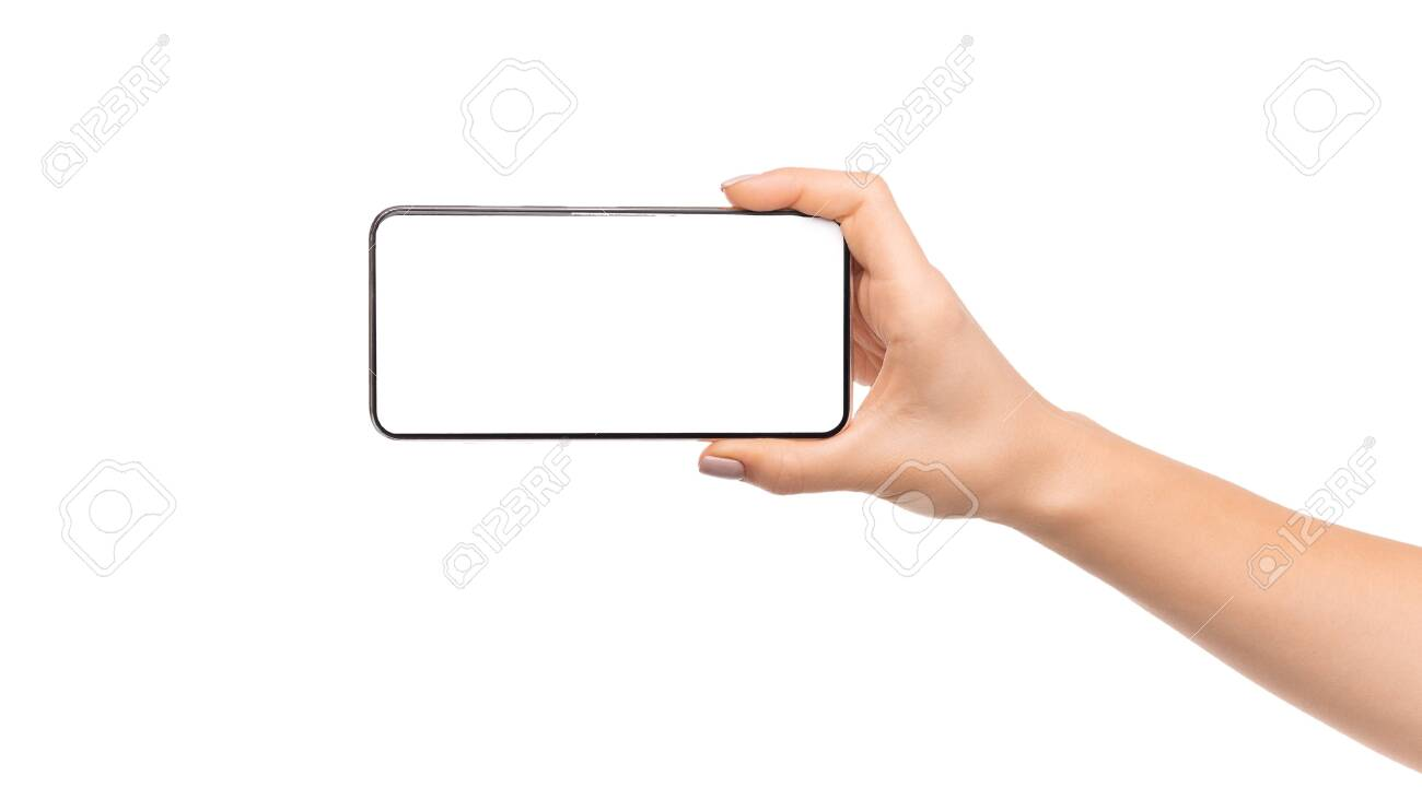 Womans hand holding modern smartphone with blank screen in horizontal orientation, panorama with copy space - 131185587