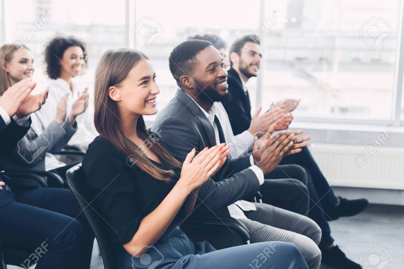 Group of business people applauding speaker after presentation in conference room - 137637596