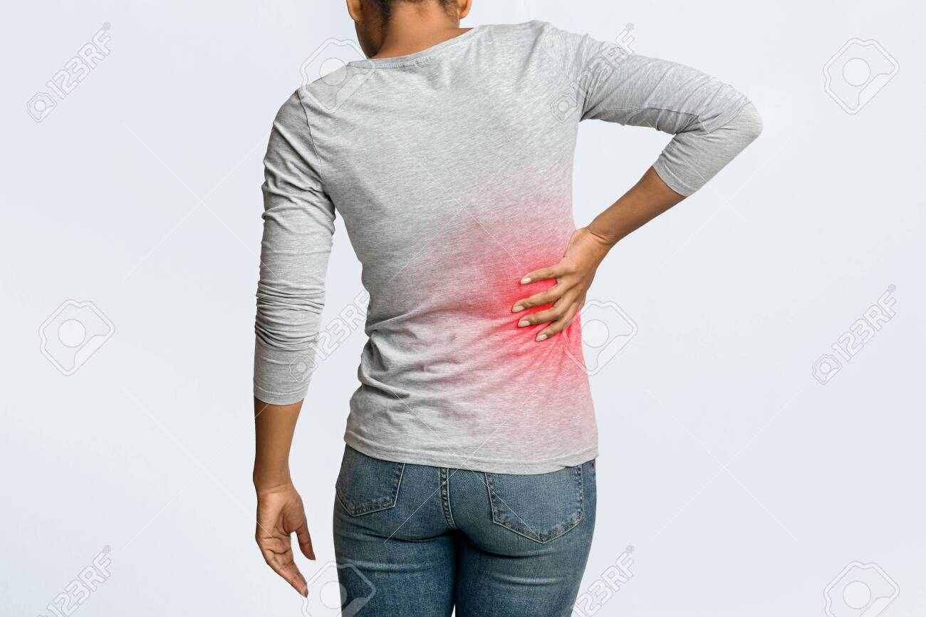 Kidney Stones Afro Woman Holding Her Hand Behind Back Pain Stock Photo Picture And Royalty Free Image Image 138394754