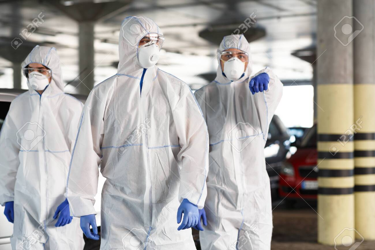 Time to protect yourself, stay at home. Men in hazmat suits pointing at you, epidemic, quarantine, copy space - 143119193