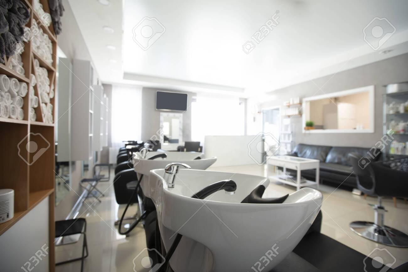 Focus on sink for washing hair. Beauty salon inside - 143325554