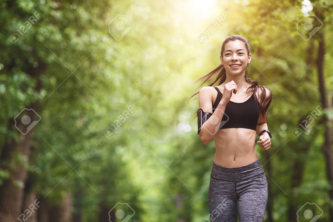 Healthy Lifestyle. Sporty Asian Girl In Jogging In City Park, Enjoying Morning Workouts, Preparing For Marathon - 150375025