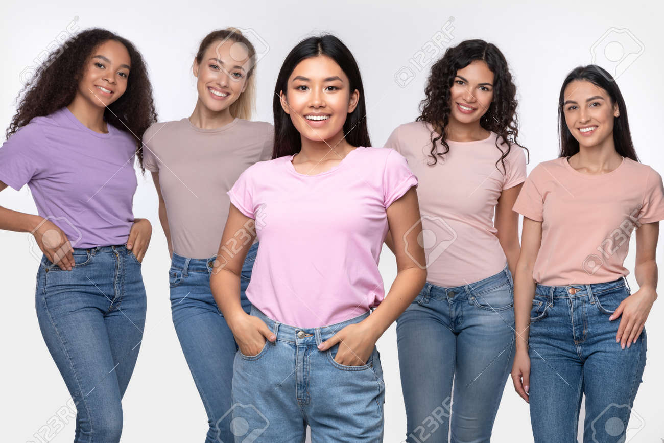 Asian Lady Standing With Group Of Happy Multiethnic Women Posing Smiling To Camera In Studio Over White Background. Female Diversity, Beauty And Friendship Concept. - 159910782