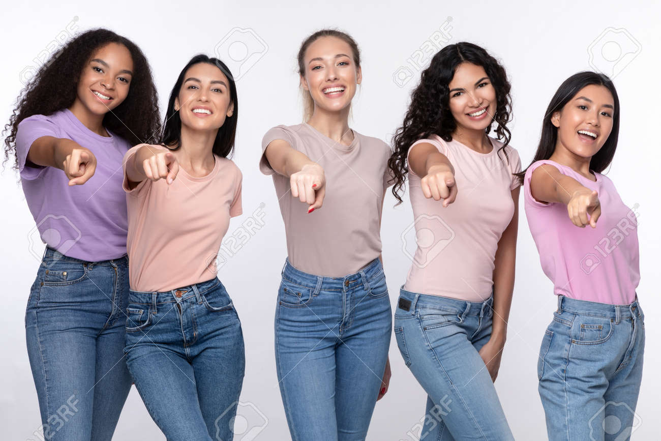 Youre Next. Positive Diverse Females Group Pointing Finger At Camera Smiling Posing Over White Studio Background. We Choose You Concept. Advertisement Banner - 159910899