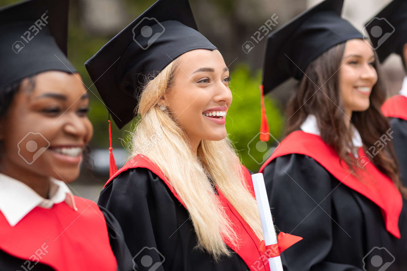 Pretty blonde lady standing among international group of students - 167759561